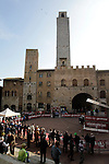 Piazza Doumo in San Gimignano for sign on before the start of the 2014 Strade Bianche race over the white dusty gravel roads of Tuscany, Italy. 8th March 2014.<br /> Picture: Eoin Clarke www.newsfile.ie