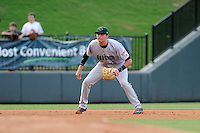 Third baseman Ryder Jones (15) of the Augusta GreenJackets in a game against the Greenville Drive on Thursday, May 22, 2014, at Fluor Field at the West End in Greenville, South Carolina. Jones was a second-round pick of the San Francisco Giants in the 2013 First-Year Player Draft. He is listed as the Giants' No. 15 prospect by Baseball America. Greenville won, 7-2. (Tom Priddy/Four Seam Images)