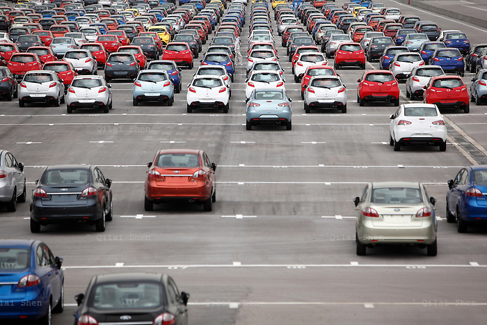 Cars parked in a storage lot at the Changan Ford Mazda Plant in Nanjing, Jiangsu Province; China, on Thursday, July 9, 2009. Ford Motor Co. said it intends to outpace industrywide sales in China, the world's fastest-growing major auto market, helped by demand for the new Fiesta.