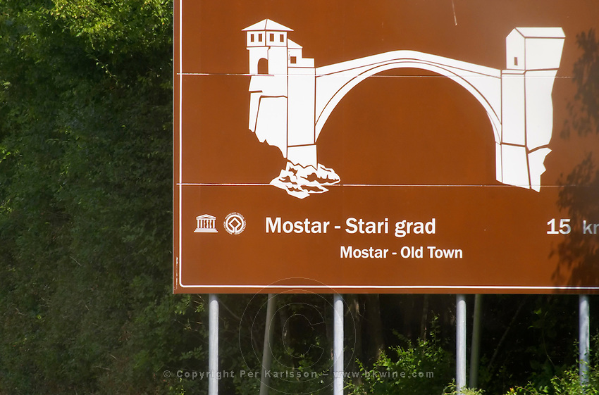 Road sign showing the old bridge in Mostar. Historic town of Mostar. Federation Bosne i Hercegovine. Bosnia Herzegovina, Europe.