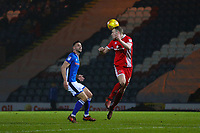 Walsall's Nicky Devlin (right) heads the ball as Rochdale's Bradden Inman (left)  looks on during the Sky Bet League 1 match between Rochdale and Walsall at Spotland Stadium, Rochdale, England on 23 December 2017. Photo by Juel Miah / PRiME Media Images.