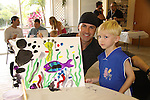 The Young and the Restless John Driscoll paints with Shamus at the Painting Party on May 15, 2011 on Marco Island, Florida - SWSL Soapfest Charity Weekend May 14 & !5, 2011 benefitting several children's charities including the Eimerman Center providing educational & outreach services for children for autism. see www.autismspeaks.org. (Photo by Sue Coflin/Max Photos)