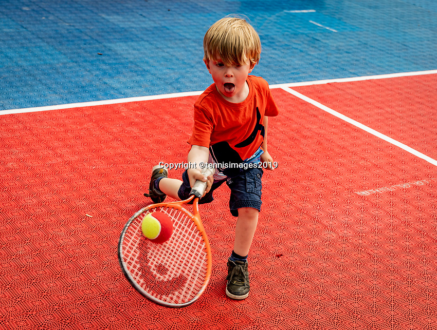 Rosmalen, Netherlands, 16 June, 2019, Tennis, Libema Open, Kid playing tennis on tennis plaza<br /> Photo: Henk Koster/tennisimages.com