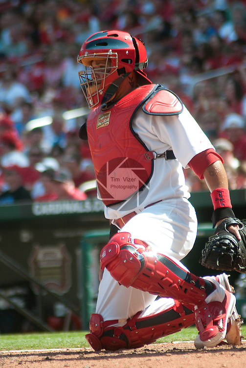 April 3,  2011                         St. Louis Cardinals catcher Yadier Molina (4) starts to get up.  The St. Louis Cardinals defeated the San Diego Padres 2-0 in the final game of a three-game series on Sunday April 3, 2011 at Busch Stadium in downtown St. Louis.