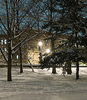 AVAILABLE FROM JEFF AS A FINE ART PRINT.<br /> <br /> AVAILABLE FROM PLAINPICTURE FOR COMMERCIAL AND EDITORIAL LICENSING.  Please go to www.plainpicture.com and search for image # p5690240.<br /> <br /> Winter Scene - Prospect Park in the Snow at Night Looking Towards Residental Buildings on Prospect Park West, Brooklyn, New York City, New York State, USA