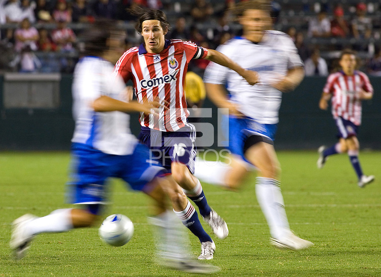 Chivas USA midfielder Sacha Kljestan (16) weaves through a maze of Earthquake players in route to the goal during a MLS match. The San Jose Earthquakes and Chivas USA played to 0-0 draw at Home Depot Center stadium on Saturday, August 23, 2008.