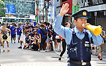 FIFA World Cup Brazil 2014 Public Viewing, June 20, 2014, Shibuya, Tokyo, Japan : Japanese Police officers try to control Japanese soccer fans on a crossroad following at the Shibuya shopping district, Sunday, June 20, 2014. (Photo by AFLO)