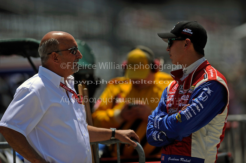 Graham Rahal (#38) with father Bobby (left).