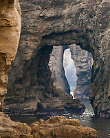Sea Stacks with arches line up perfectly for compelling landscape at Futo Beach on the Izu Peninsula of Japan.