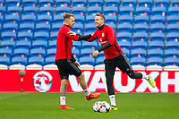 Aaron Ramsey and Chris Gunter stretch during Wales national team training ahead of the World Cup Qualification match against Republic of Ireland at Cardiff City Stadium, Cardiff, Wales on 8 October 2017. Photo by Mark  Hawkins.