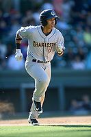 Third baseman Oswaldo Cabrera (10) of the Charleston RiverDogs runs out a batted ball in a game against the Greenville Drive on Sunday, April 29, 2018, at Fluor Field at the West End in Greenville, South Carolina. Greenville won, 2-0. (Tom Priddy/Four Seam Images)