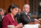 "Seema Verma, Administrator, Centers for Medicare & Medicaid Services, US Department of Health and Human Services, left, reads her opening statement as she testifies before the United States Senate Committee on Homeland Security & Governmental Affairs during a hearing entitled ""Examining CMS's Efforts to Fight Medicaid Fraud and Overpayments"" on Capitol Hill in Washington, DC on Tuesday, August 21, 2018.  Looking on at right is Eugene L. Dodaro, Comptroller General of the United States, US Government Accountability Office.<br /> Credit: Ron Sachs / CNP"