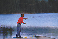 Terry Sheely cast for trout off a dock at Lac La Roche in northern British Columbia, Canada.