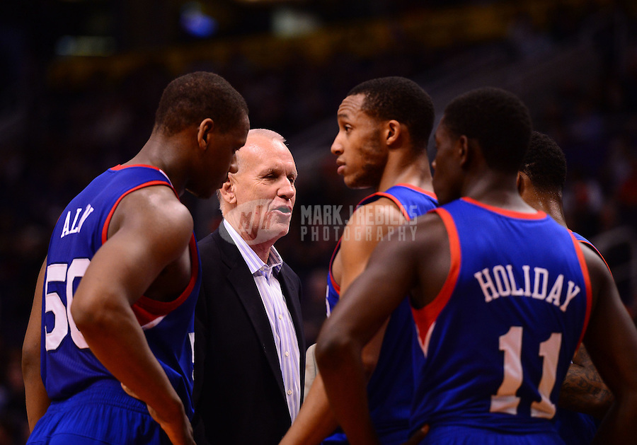 Jan. 2, 2013; Phoenix, AZ, USA: Philadelphia 76ers head coach Doug Collins talks to his team during a time out in the second half against the Phoenix Suns at the US Airways Center. The Suns defeated the 76ers 95-89. Mandatory Credit: Mark J. Rebilas-USA TODAY Sports