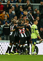 9th November 2019; St James Park, Newcastle, Tyne and Wear, England; English Premier League Football, Newcastle United versus AFC Bournemouth; Ciaran Clark of Newcastle United is congratulated by Paul Dummett Jetro Willems  Federico Fernandez and Joelinton of Newcastle United with Miguel Almiron of Newcastle United jumping on his team mates after he scores in the 52nd minute to make it 2-1 - Strictly Editorial Use Only. No use with unauthorized audio, video, data, fixture lists, club/league logos or 'live' services. Online in-match use limited to 120 images, no video emulation. No use in betting, games or single club/league/player publications
