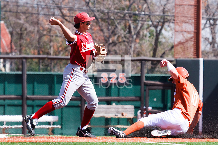 AUSTIN, TEXAS-March 6, 2011:  Kenny Diekroeger of Stanford turns a double play during the game against the Texas Longhorns, at Disch-Falk field in Austin, Texas.  Texas defeated Stanford 4-2.