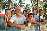 Future-hopeful Major Leauge baseball players practice near the beach in Rio San Juan, Dominican Republic