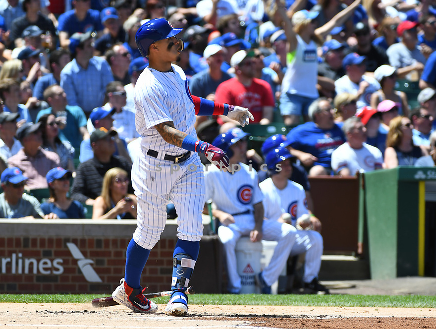 CHICAGO IL - May 18, 2017: Javier Baez #9 of the Chicago Cubs during a game against the Cincinnati Reds on May 18, 2017 at Wrigley Field in Chicago, IL. The Cubs beat the Reds 9-5.(David Durochik/ SportPics)