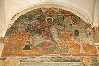Pictures &amp; images of the medieval fresco of St George over the doorway of the Alaverdi St George Cathedral &amp; monastery complex, 11th century, near Telavi, Georgia (country). <br /> <br /> At 50 meters high Alaverdi St George Cathedral was once the highest cathedral in Georgia (now its the nes Tblisi cathedral). The cathedral is part of a Georgian Orthodox monastery founded by the monk Joseph [Abba] Alaverdeli, who came from Antioch and settled in Alaverdi. On the UNESCO World Heritage Site Tentative List.