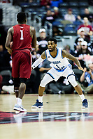 Washington, DC - MAR 10, 2018: Rhode Island Rams guard Jarvis Garrett (1) plays defense against Saint Joseph's Hawks guard Shavar Newkirk (1) during the semi final match up of the Atlantic 10 men's basketball championship between Saint Joseph's and Rhode Island at the Capital One Arena in Washington, DC. (Photo by Phil Peters/Media Images International)