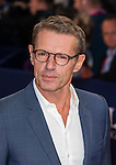 French actor Lambert Wilson poses on the red carpet as he arrives for the screening of the premiere of 'The November Man' during the 40th Deauville American Film Festival on September 5, 2014 in Deauville,