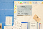 November 15, 2011. Mooresville, NC.. Passwords, laptop care instructions and regulation posters are posted all over the walls at East Mooresville Intermediate School, where students are issued laptops to be used in many of their classes.. The Mooresville school system has become nationally known for being on the cutting edge of using technology as an educational tool. Starting in 3rd grade, each student is issued their own laptop that they will use in class and at home to further their learning.