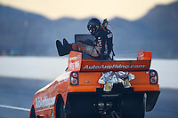 Oct 31, 2015; Las Vegas, NV, USA; NHRA funny car driver Brandon Welch climbs from the emergency roof escape hatch after an engine fire during qualifying for the Toyota Nationals at The Strip at Las Vegas Motor Speedway. Mandatory Credit: Mark J. Rebilas-USA TODAY Sports