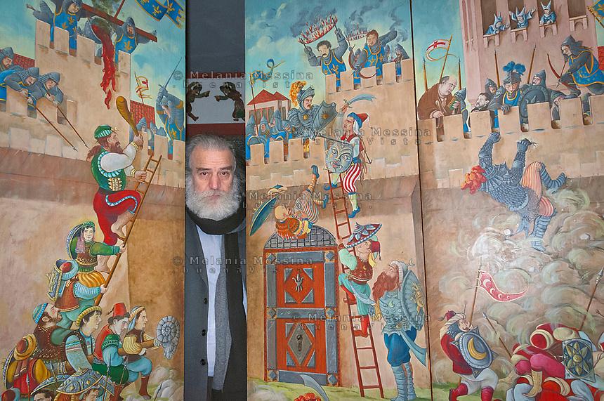 Mimmo Cuticchio behind the doors of his theatre..Il puparo Mimmo Cuticchio dietro le porte d'ingresso del suo teatro