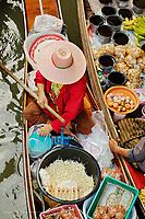 Thai woman preparing food, Damnoen Saduak Floating Market, Damnoen Saduak, Thailand