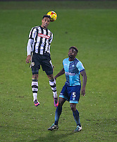 Vadaine Oliver of Notts Co wins the ball over Anthony Stewart of Wycombe Wanderers during the Sky Bet League 2 match between Notts County and Wycombe Wanderers at Meadow Lane, Nottingham, England on 10 December 2016. Photo by Andy Rowland.