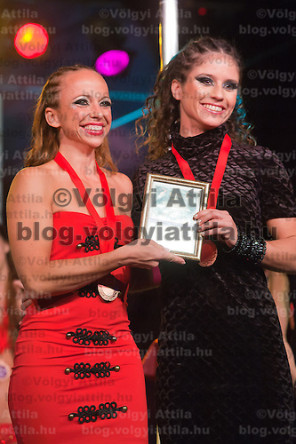 Barbara Palmaffy (L) and Ilka Martina Bardoczy (R) from Hungary celebrate their victory in the doubles category of the World Pole Sport & Fitness Championships 2011 in Budaors, near Budapest, Hungary on October 01, 2011. ATTILA VOLGYI