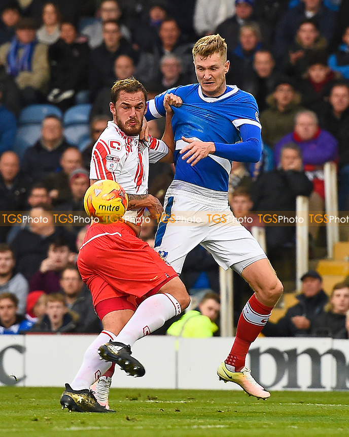 Luke Wilkinson of Stevenage gets to grips with Michael Smith of Portsmouth during Portsmouth vs Stevenage, Sky Bet EFL League 2 Football at Fratton Park on 26th November 2016
