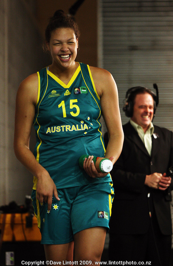 Opals centre Elizabeth Cambage and Sky commentator Dan Hennessey share a joke after the one-sided match during the International women's basketball match between NZ Tall Ferns and Australian Opals at Te Rauparaha Stadium, Porirua, Wellington, New Zealand on Monday 31 August 2009. Photo: Dave Lintott / lintottphoto.co.nz