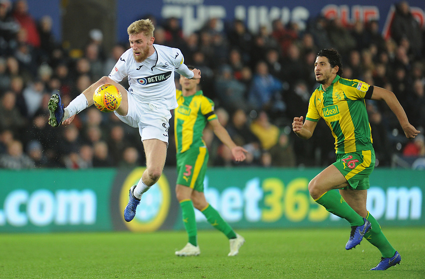 Swansea City's Oli McBurnie controls the ball<br /> <br /> Photographer Kevin Barnes/CameraSport<br /> <br /> The EFL Sky Bet Championship - Swansea City v West Bromwich Albion - Wednesday 28th November 2018 - Liberty Stadium - Swansea<br /> <br /> World Copyright © 2018 CameraSport. All rights reserved. 43 Linden Ave. Countesthorpe. Leicester. England. LE8 5PG - Tel: +44 (0) 116 277 4147 - admin@camerasport.com - www.camerasport.com