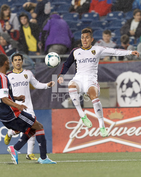Real Salt Lake defender Carlos Salcedo (16) works to clear ball. In a Major League Soccer (MLS) match, Real Salt Lake (white)defeated the New England Revolution (blue), 2-1, at Gillette Stadium on May 8, 2013.