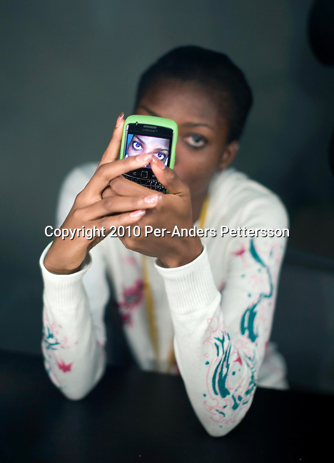 JOHANNESBURG, SOUTH AFRICA - MARCH 27: Nigerian model Tarmar Awobuto waits for make-up backstage before a fashion show at the South African fashion week on March 27, 2010, Turbine Hall in central Johannesburg, South Africa. Buyers and celebrities watched the 3 day fashion week, a biannual event. (Photo by Per-Anders Pettersson)