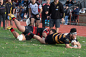 Haamiora Clarke dives over to score the first of his 2 tries for the game. Counties Manukau Premier Club Rugby game between Papakura and Bombay, played at Massey Park Papakura on Saturday June 16th 2018. Bombay won the game 36 - 17 after leading 17 - 7 at halftime.<br /> Papakura Ray White 17 - Kris Smithson 2, Taafaga Tagaloa tries, Monty Punatai conversion.<br /> Bombay 36 - Jordan Goldsmith, Haamiora Clarke 2, Patrick Masoe, Mitchell Thackham, Chay Mackwood tries, Jordan Goldsmith 2, Ki<br /> Anufe conversions.<br /> Photo by Richard Spranger.