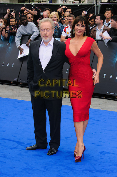 Sir Ridley Scott & Giannina Facio.'Prometheus' film premiere held at the Empire Leicester Square, .London, England , UK, 31st May 2012..full length black suit red dress sleeveless married husband wife beard facial hair  .CAP/CJ.©Chris Joseph/Capital Pictures.