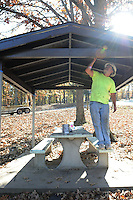 NWA Democrat-Gazette/FLIP PUTTHOFF <br /> SHELTER IMPROVEMENTS<br /> Travis Lawson paints a picnic pavilion Wednesday Nov. 4, 2015 at Prairie Creek park on Beaver Lake. Lawson, with Hill and Hill Environmental, said workers are painting and repairing 31 pavilions at the park. The company does work for the U.S. Army Corps of Engineers at Beaver and Table Rock lakes, Lawson added.