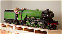 BNPS.co.uk (01202) 558833<br /> Picture: Laura Jones<br /> <br /> Chuffed...<br /> <br /> The model train world is getting steamed up over a superb collection of immaculate 7 1/4 guage locos being sold at Dreweatts auctioneers near Newbury.<br /> <br /> Tessa Parry from Dreweatts with 'Flying Scotsman' valued at &pound;30,000<br /> <br /> A train enthusiast's stunning collection of model steam engines he used to happily drive around his garden is tipped to sell for over &pound;200,000. <br /> <br /> With the help of his family the late Don Witheridge from Norfolk laid three-quarters of a mile of track on his five acres of land he bought from British Rail and commissioned prominent locomotive builders to make model steam engines. <br /> <br /> The locos are exact working replicas of real engines from the golden age of steam