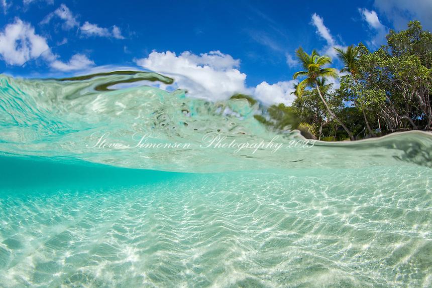 Split level view of Caneel Bay Beach<br /> Virgin Islands National Park<br /> St. John<br /> U.S. Virgin Islands