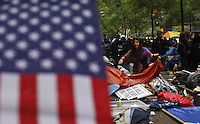 "New York, United States, October 4, 2011..Hundreds of protesters from the movement ""Occupy Wall Street"" continue for 19th day of peaceful protests against the economic system around Wall Street in Zuccotti Park in New York. October 4, 2011. VIEWpress / Eduardo Munoz Alvarez..In New York, the Occupy Wall Street movement (which began on the 17th September this year) has spread throughout the country. What started as a peaceful protest to campaign against capitalism has now taken root in other cities such as Chicago and Boston. They claim to have been inspired by Egypt's Tahrir Square protests. Even Anonymous, the ""hacktivists"", have emerged from their computer caves to take to the streets. Local Media Reported."