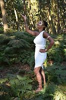 Latitude Festival, Henham Park, Suffolk, UK July 2018. Woman dressed in Ancient Greek fancy dress in the woods