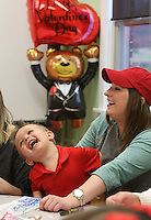 NWA Democrat-Gazette/DAVID GOTTSCHALK  Max Miley, 3, shares a laugh with Ferrin Webb, a senior and Pre-School Teacher at the University of Arkansas Autism Research Clinic, Tuesday, February, 14, 2017, during a Valentines Day Party on the campus in Fayetteville. The pre-school students and alumni students participated in the activities that included making a Valentines Day Ladybug, decorated goodie bags and making a strawberry shortcake.