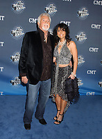 """20 March 2020 - Kenny Rogers, whose legendary music career spanned nearly six decades, has died at the age of 81. Rogers was inducted to the Country Music Hall of Fame in 2013."""" He had 24 No. 1 hits and through his career more than 50 million albums sold in the US alone. He was a six-time Country Music Awards winner and three-time Grammy Award winner. Some of his hits included """"Lady,"""" """"Lucille,"""" """"We've Got Tonight,"""" """"Islands In The Stream,"""" and """"Through the Years."""" His 1978 song """"The Gambler"""" inspired multiple TV movies, with Rogers as the main character. File Photo: 10 April 2006 - Nashville, Tennessee - Kenny Rogers. 2006 CMT Music Awards held at The Curb Event Center at Belmont University. Photo Credit: Laura Farr/AdMedia"""