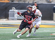 College Park, MD - April 15, 2018: Rutgers Scarlet Knights Christian Mazzone (21) gets pushed in the back during game between Rutgers and Maryland at  Capital One Field at Maryland Stadium in College Park, MD.  (Photo by Elliott Brown/Media Images International)