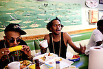 Playa Fly (right) eats lunch at Flying Fish with Drumma Boy in downtown Memphis, Tennessee, October , 2011.