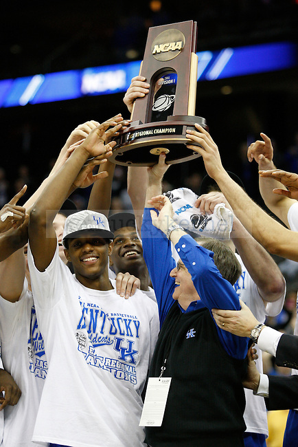 Lee T. Todd Jr. holds up the trophy with the team after defeating UNC in the Elite 8 game of the 2011 NCAA Basketball Tournament, at the Prudential Center, in Newark, NJ.  Photo by Latara Appleby | Staff