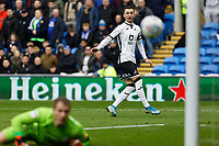 Bersant Celina of Swansea City (R) kicks the ball past Alex Smithies of Cardiff City (L) during the Sky Bet Championship match between Cardiff City and Swansea City at the Cardiff City Stadium, Cardiff, Wales, UK. Sunday 12 January 2020