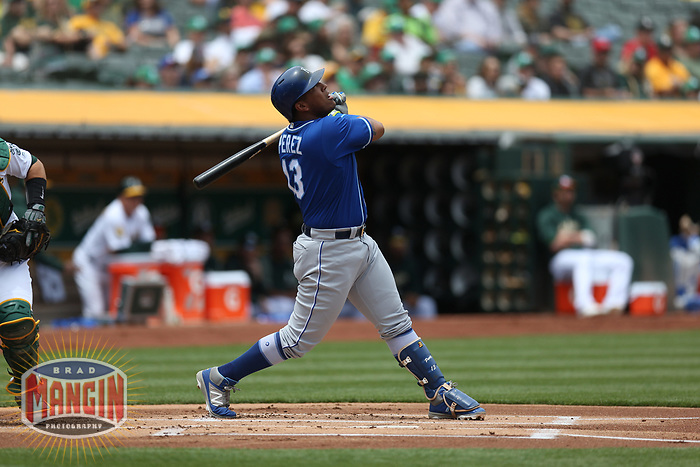 OAKLAND, CA - JUNE 9:  Salvador Perez #13 of the Kansas City Royals bats against the Oakland Athletics during the game at the Oakland Coliseum on Saturday, June 9, 2018 in Oakland, California. (Photo by Brad Mangin)